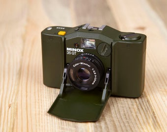 Vintage Camera Minox 35 GT Golf. Special Edition Minox 35 GT. Working Compact Camera. Olive-drab color.