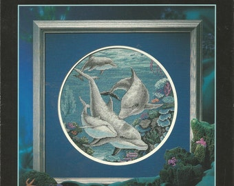 1998 Dimensions Dancing Dolphins cross stitch leaflet.  Very colorful cross stitch..