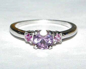 Beautiful Platinum Ring with 3 Sparkling Amethyst Stones - size 6