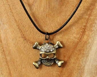 Antiqued Gold Skull necklace with clear rhinestones on a leather cord, pirate necklace, simple necklace, biker, goth, cosplay skull necklace