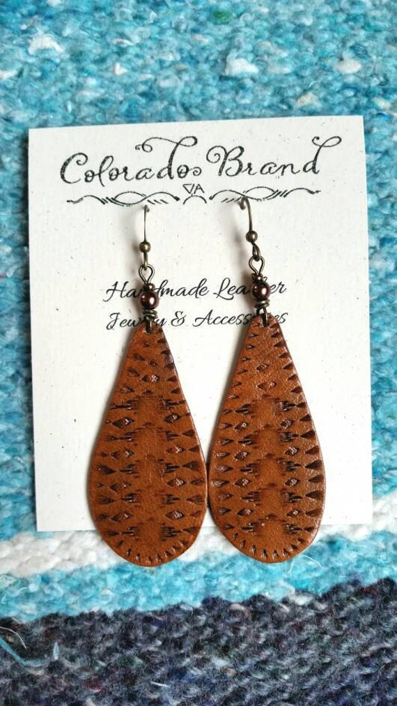 items similar to hand made leather earrings with