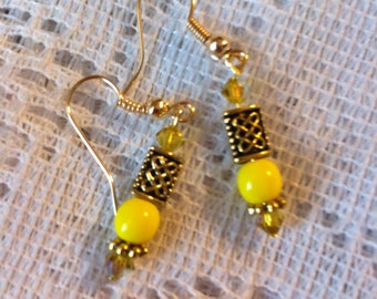 Yellow and gold plated pierced earrings with Celtic knot beads