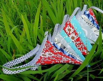Summer bunting.  Double sided bunting.  230cm,   with an additional 25cm at each end for tying.  11 flags.  Fabric bunting.
