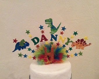 Handmade dinosaur cake topper . Made with your choice of name and age