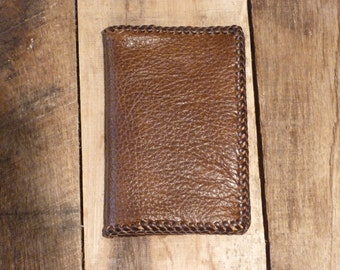 Brown grainy handmade leather wallet, 8 pockets for cards and opening for bills, laces, country western style