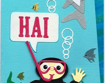 """A """"Hai"""" greeting card with diver and shark"""