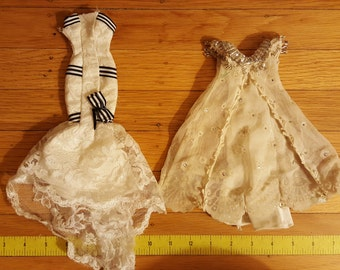 """Two Barbie costumes for Eliza Doolittle, the heroine of the musical """"My Fair Lady's"""" -- the Embassy ball gown and the Ascot races gown"""