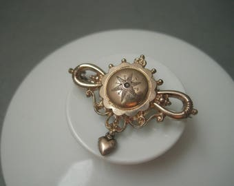 Delicate romantic antique gilt silver brooch with a seed pearl.