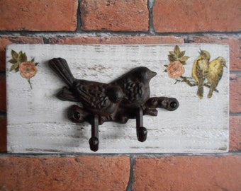 Cast Iron Bird Hook Rack on Distressed Wooden Board