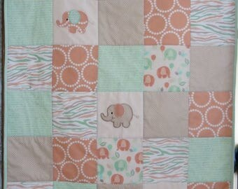 Cot quilt, elephants in green, peach and beige