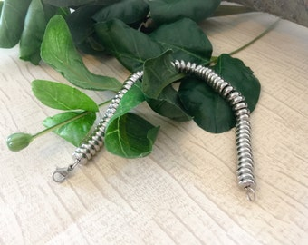 Bracelet with stainless steel bead