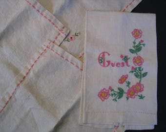 4 piece lot of vintage linens. Guest fingertip towel, 3 napkins. hand embroidered pink and green floral on white.