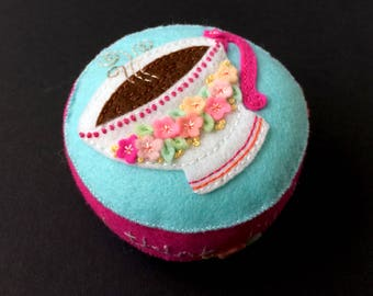 pink and blue wool felt cup pincushion with lots of flowers and hand embroidery