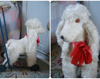 Vintage pushalong poodle toy dog, dog on wheels, Wendy Boston