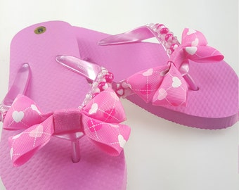 Girls pink heart flip flops with pink bow