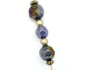 Vintage style hat pin in shades of midnight blue and gold