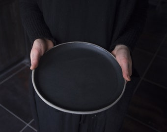 Handmade handcrafted anthracite stoneware plate, satin black matte glaze, natural nordic rustic