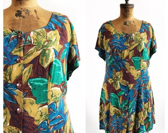 Plus size rayon earth tone floral short and swingy dress with front buttons and adjustable ties in the back. Size 2XL.