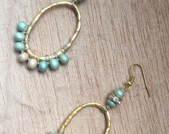 Drop earrings with green and beige beads