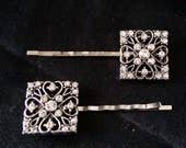Set Of 2 Silver Metal Hair Pins With Silver Square Ornaments Featuring Hearts And Covered In Crystals