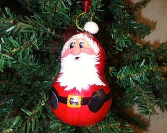Small hand painted Santa ornament on bottle gourd by Debbie Easley 41