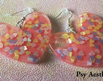 Large pink heart earrings