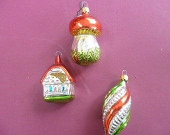 Three vintage Christmas ornaments: a spiral, mushroom and a house.