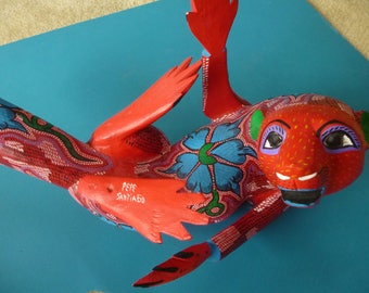 Red hand carved otter (Alebrije) made in Mexico