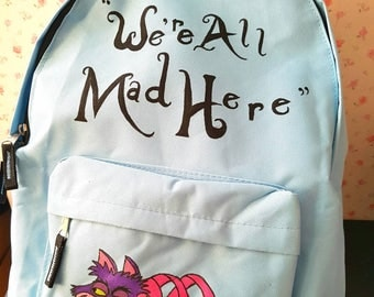 Cheshire cat backpack. We're all mad here bag. Alice in wonderland bag