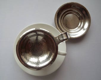 Vintage Tea Strainer and Drip Bowl. Silverplate looseleaf tea infuser with beaten silver effect. Very unusual. Ideal for a vintage tea party