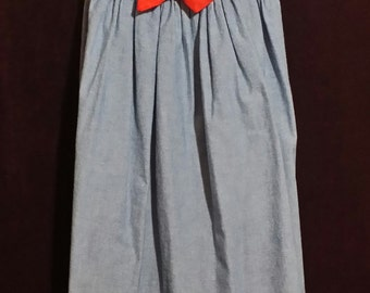 Litttle girl blue sailor dress, with front red decriotive bow, large white sailor collar. size 7