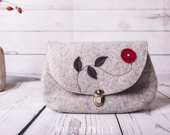 Clutch made of wool felt with applications of felt and metal