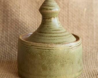 matte sage green small handmade ceramic covered jar