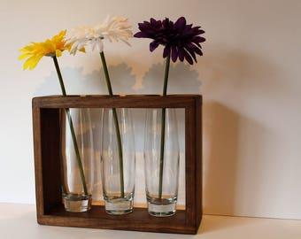 Solid walnut and birdseye maple vase box.  One side is walnut and the other is birds eye maple. Includes three 7&1/2 inch  bud vases.