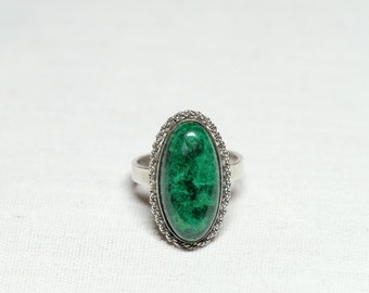 Sterling silver adjustable ring with a green cabochon