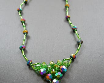 Sparkly green crystal bead necklace with small apron detail