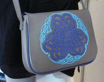 Grey shoulder bag with blue celtic enterlace