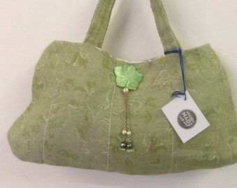 Delicious little green bag with fab flower adornment to the front