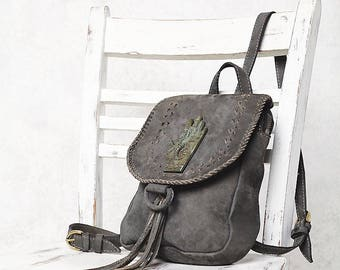 La Reina Grey Leather Mini Backpack with metal detailing