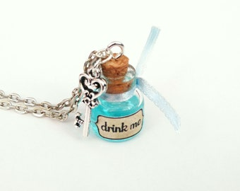 Alice in Wonderland drink me Alice chain necklace glass bottle blue