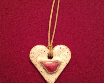 Cream speckled ceramic heart with red bird