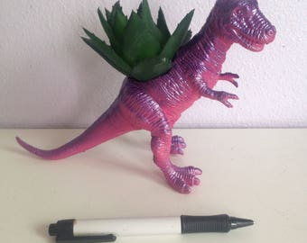Lexy, the pink and purple sparkly Trex planter, with realistic succulent