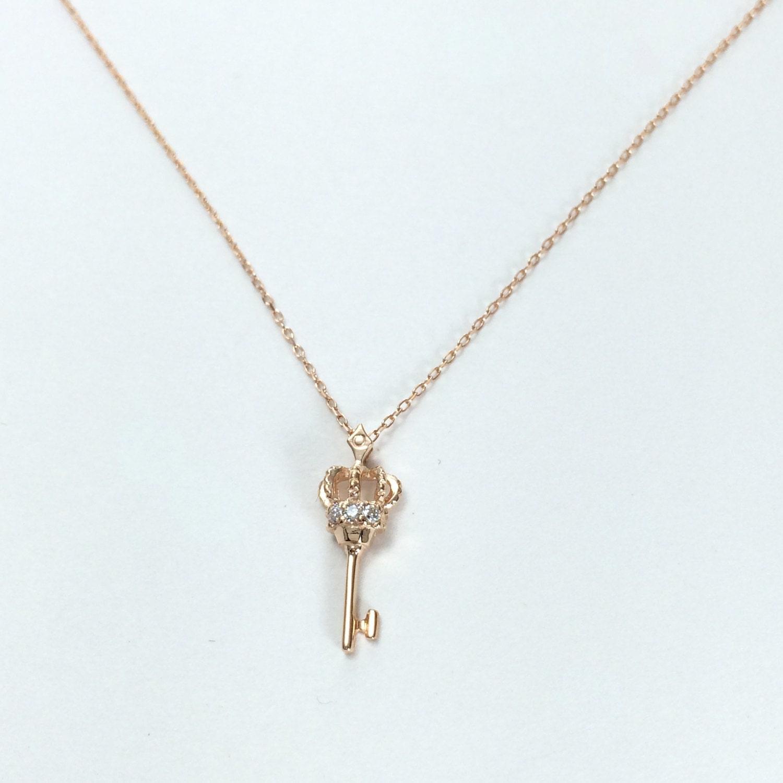 gold key pendant dainty diamond necklace symbolic jewelry. Black Bedroom Furniture Sets. Home Design Ideas