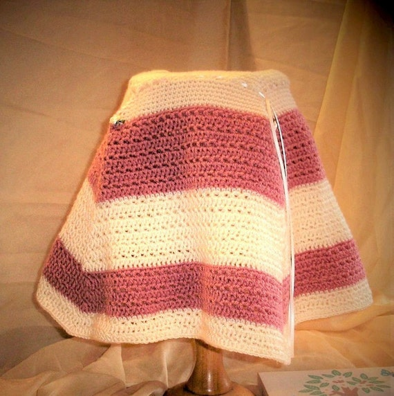 Baby Girl warm, cosy, Poncho crochete in soft cream and dusky pink wool. Ribbon Tie neck & rose bud detail. (Age 3-12 months)