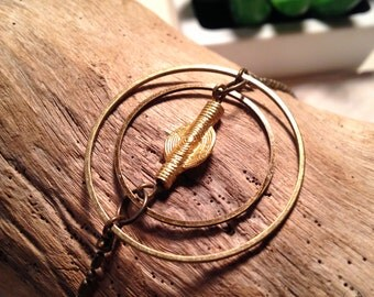 Circle bracelet with gold bead
