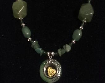 Green aventurine with spinning Buddha pendant