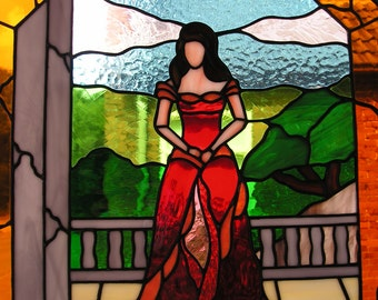 Tiffany stained glass suncatcher or panel depicting a beautiful lady in red dress standing on her balcony, amazing window decoration or gift