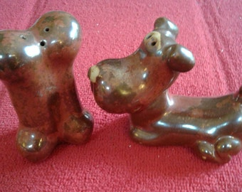 Who doesn't love a dog and his bone? Salt and Pepper Collectibles