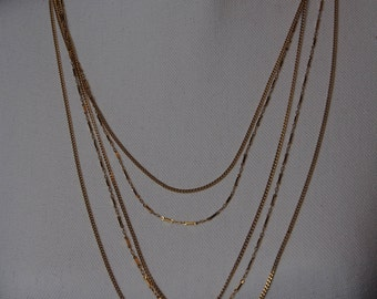 Darling multi-chain Monet necklace!