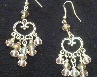 Silver tone heart chandelier earrings with crystals